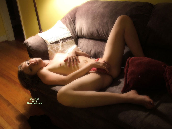 Pic #1 - Nude Girlfriend Spreading Her Legs On A Couch - Brown Hair, Long Hair, Long Legs, Red Hair, Small Tits, Spread Legs, Topless, Naked Girl, Nude Amateur, Sexy Girlfriend , Hand On Pussy, Flat Belly, Spread Legs, Red Thong Pulled To One Side, Red Lace Panty, Topless Laying On Couch