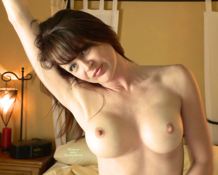 Pic #1 - Arm Raised - Blue Eyes, Dark Hair, Large Breasts, Pale Skin, Perky Nipples , Pale Skin, Pointed Nipples, Slight Grin, Tattooed Neck, Shaved Armpits, Head To One Side