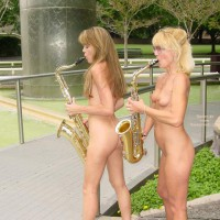 Two Nude Girls Playing Instrument - Girls, Nude In Public