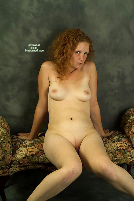Pic #1 - Shy Redhead On A Settee - Milf, Red Hair, Shaved Pussy, Small Tits , Red Head, Pale Naked, Leaning Back On Hands, Knees Joined Legs Apart, Full Frontal, Sitting Knees Together, White Milf