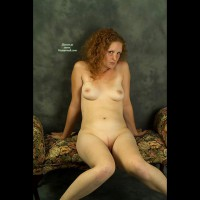 Shy Redhead On A Settee - Milf, Red Hair, Shaved Pussy, Small Tits