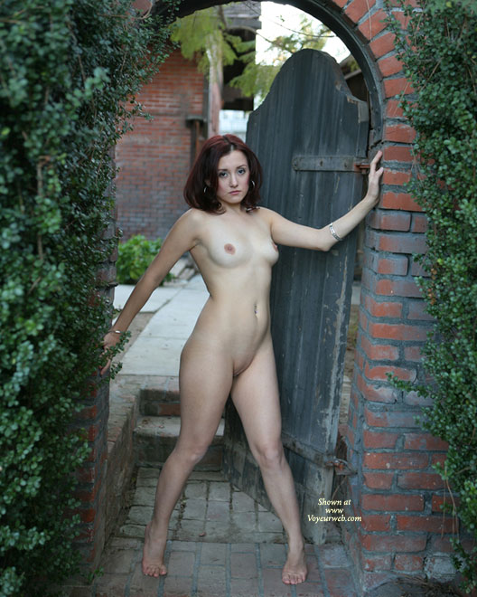 Pic #1 - Naked At Patio Gate - Dark Hair, Nude In Public, Perfect Tits, Red Hair, Shaved Pussy, Naked Girl, Nude Amateur , Nude Art, Nude In Garden Doorway, Public Nudity, Standing In A Doorway, Outside Naked, Green Hedges, Curvy, Red Bricks, Dark Red Hair, Framed In Archway