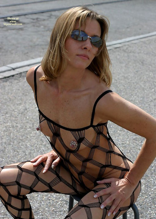 Sexy Bodystocking In Public - Sunglasses , Nipple Shields, Dressed In Net In Public, Nipple Jewelry, Dark Sunglasses, Sleeveless Bodystocking, Sitting On A Chair, Black String Body Stocking, Stringy Hair