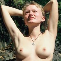 Medium tits of a neighbor - Sandy