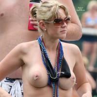 exposing her pierced nipples