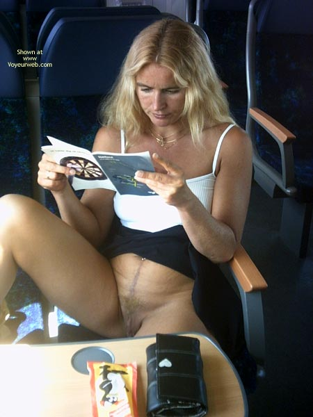 Pic #1 - Pantyless In Train - Blonde Hair, Pussy Flash , Pantyless In Train, Flashing Pussy, Blonde Hair, Reading Book, Blond Milf, Airing The Goods, Public Display, Flashing Blond