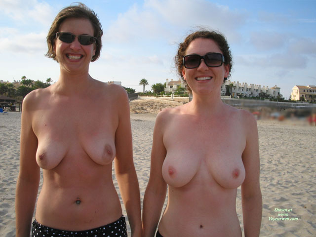 Pic #1 - Two Girls Showing Their Tits On The Beach - Topless , Topless On Beach, Toppless Beach, Breasts And Belly Exposed, Smiling To Camera, Topless Pair Holiday Shot, Breasts Beach Milfs, Toppless Outdoors, Mature Pair Showing Off Tits, Smiling Faces, Two Women Topless On Public Beach