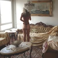 Rearview Of Topless Girl In Elegant Room - Tan Lines, Topless