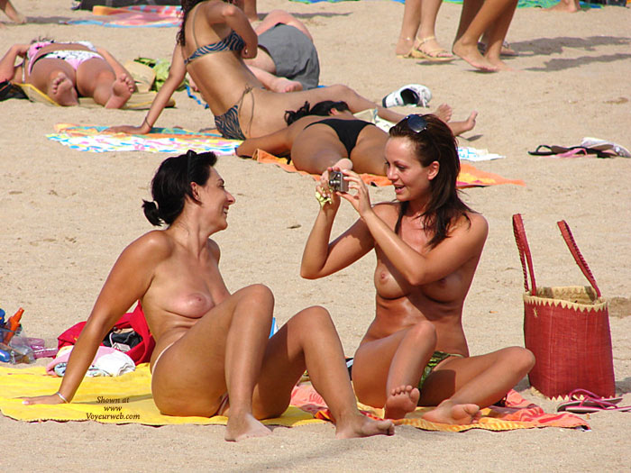Pic #1 - Topless Women Sitting At Beach - Topless, Beach Voyeur, Naked Girl, Nude Amateur , Two Topless Taking Pictures, Taking Pictures At Nudes On Beach, Beach Pictures Two Girls, Beach Shot, Two Topless Girls Having Fun In The Sun, Nude At Beach, Topless Beach, Beach Nude, Topless Beach Photo Op, Two Topless Women Sitting Outdoors