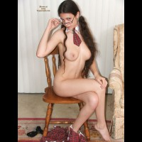 Naked On Chair With Glasses And Short Plaid Tie - Brunette Hair, Erect Nipples, Large Breasts, Long Hair