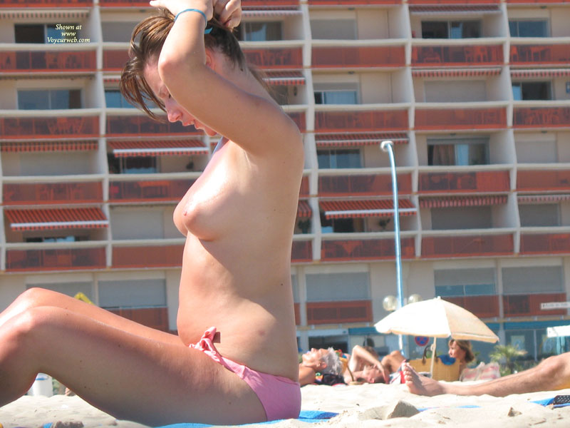 Pic #1 - Topless At The Beach - Brown Hair, Topless Beach, Topless, Beach Voyeur , Beach Beauties, Topless Gal With Pink Bikini Bottoms., Beach Tits, Topless Girl In Beach Putting Her Hair Up., Voyuer, Topless Sunbather In Profile, Pink Areolas