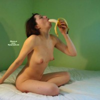 Nude Sitting On Bed Eating Banana - Naked Girl, Nude Amateur
