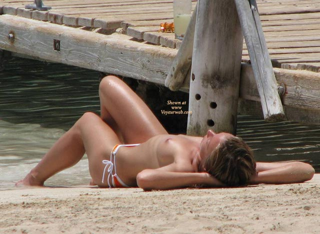 Pic #1 - Topless Girl Sunbathing - Brown Hair, Small Breasts, Topless, Beach Voyeur , Orange White Bikini, Bikini