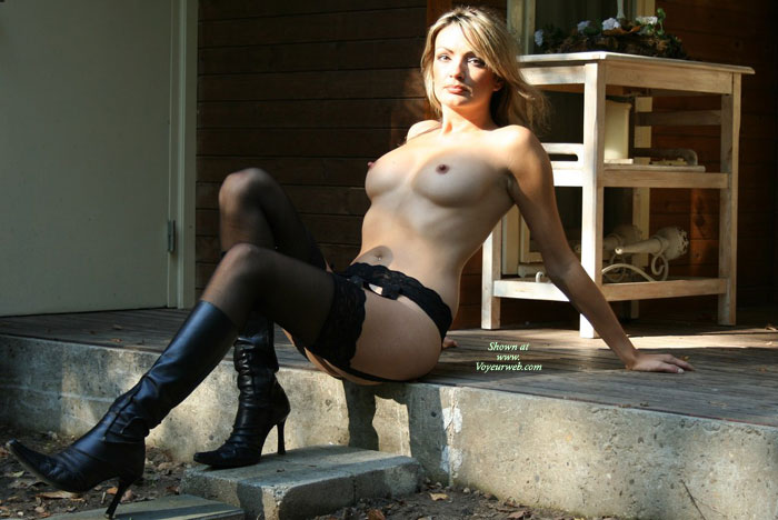 Pic #1 - Artistic Outdoors - Perky Nipples, Stockings, Small Areolas , Naked Outside, Black Suspenders, Black High Heel Boots, Contrasts In Colors, Pointed Nipples, Naked In Heels, Sexy Mature, Reclining On The Edge Of The Step