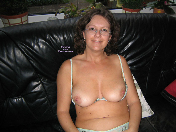 Pic #1 - Mature Topless On Couch - Brunette Hair, Topless , Girl With Glasses, Exposed Boobs, Topless Mature Brunette