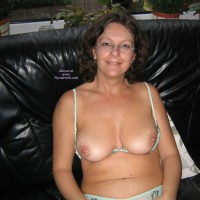 Angel: mature topless on couch