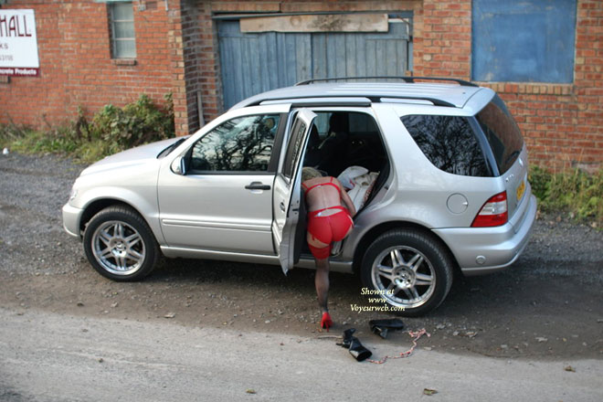 """Pic #1 - GIRL Changing Next To Car - Heels , Unstrapped Red Garder Belt, Sheer Red Panies, Rear View, Silver M-class With 20"""" Amg-rims, Red Suspender Belt, Red Lingerie"""