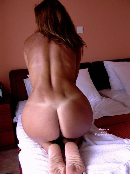 Pic #1 - Kneeling With Hands In Front To Put Tension In Her Back Muscles - Round Ass, Tan Lines , Feet Together, Hourglass Shape, Showing Off Perfect Tan Lines, Kneeling On Bed, Showing Her Nice Round Ass, Round Shapely Ass, Back To Camera, Sexy Back