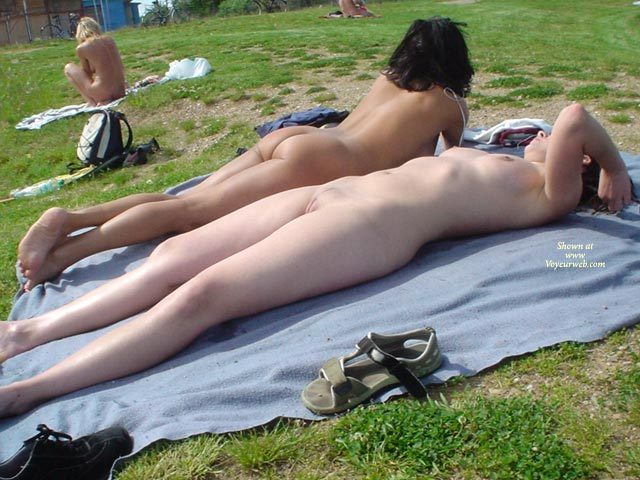 sunbathing in public nude Woman