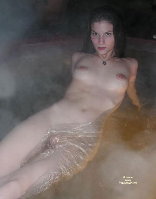 Pic #1 - Naked Girl Floating In A Spa - Black Hair, Large Aerolas , Lying Back In Hot Tub, Wet Titties, Hands Behind Back, Naked In Tub, Watching To The Camera, Sculpted Eyebrows, Naked In Water