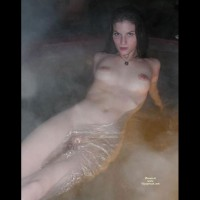 Naked Girl Floating In A Spa - Black Hair, Large Aerolas