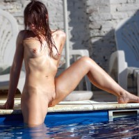 campanita: naked on edge of pool with legs spread