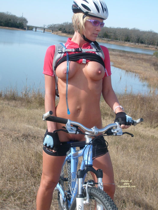 Flashing On A Bike - Erect Nipples, Flashing, Shaved Pussy , Biking Shorts, Bike Helmet, Black And White Biker's Helmet, Flashing In A Park, Large Erected Nipples, Pink Shirt, Bike Shirt And Shorts, Purple Tinted Goggles