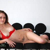 Red Cupless Bra - Brunette Hair, Shaved Pussy, Small Tits, Small Areolas , Just In A Quarter Cup Red Bra, Red Fingernails, Crossed Legs, Tummy Tattoo, Slim Body, Artistic On Couch, Small Round Areolas, Red Bra