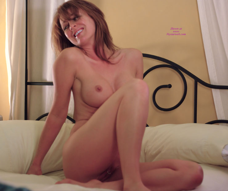 Nude Milf - Milf, Naked Girl, Nude Amateur , One Leg Folded Under - The Other Folded Upward, Clit Ring, Pussy Ring, Beautiful Breasts, Seated With Legs Folded In, Right Leg Raised To Expose The Yumm Yumm, Seated On Bed, Round Aerola, Sitting Naked In Bed, Full Round Breasts