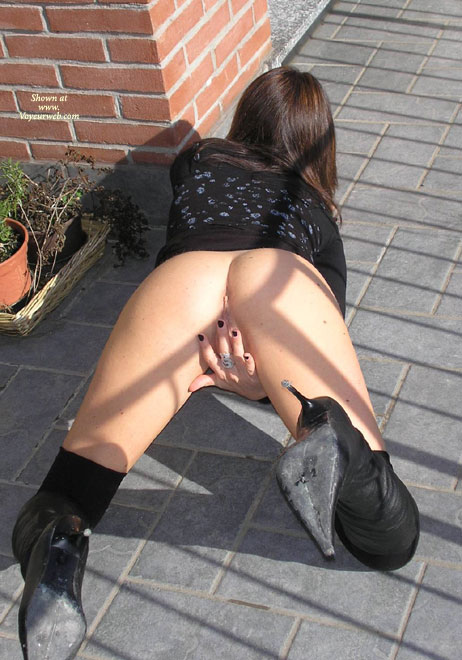 """Pic #1 - On All Fours Outside On Patio No Panties - Dark Hair, Doggy Style, Long Hair , View From Behind, Black Sweater With Blue Print, No Panties, Black Pointy-toed Boots, Covering Her Pussy With Her Hand, Black Leather Boots With 4"""" Spike Heels, Ass Shot Only Outdoors No Face, Wfi On The Patio, Ass In The Air, Fingers Covering Pussy, On Her Hands And Knees No Panties"""