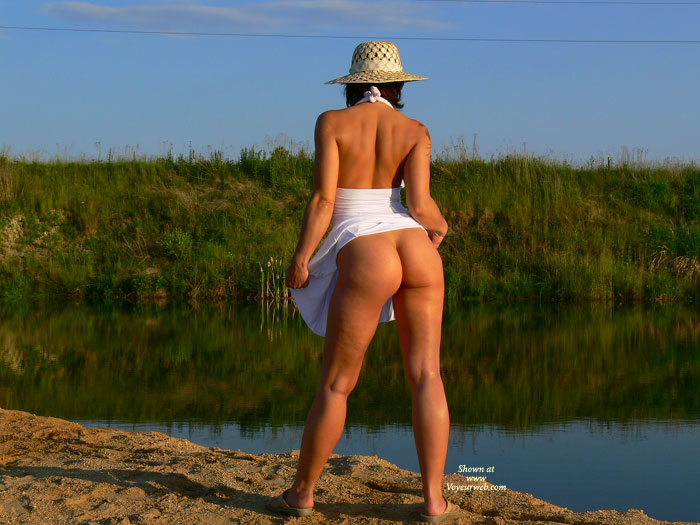 Pic #1 - Brunette Flashing Her Ass At The Lake - Brunette Hair, Flashing Ass, Flashing, Sexy Ass , White Dress Pulled Up, Standing Ass View With Arched Back, Beauty By The Lake, Strapless White Dress, Flashed Bum At Pond, White Halter Dress, Outdoor Stylish Pose Naked Bum, Brown Flip Flops, Outdoor Bottomless Raised Skirt, A Golden Girl By Pond, Staw Hat