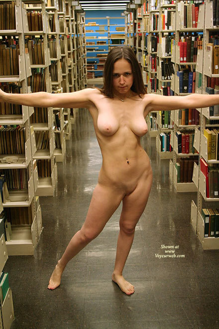Nude Girl Standing In Library
