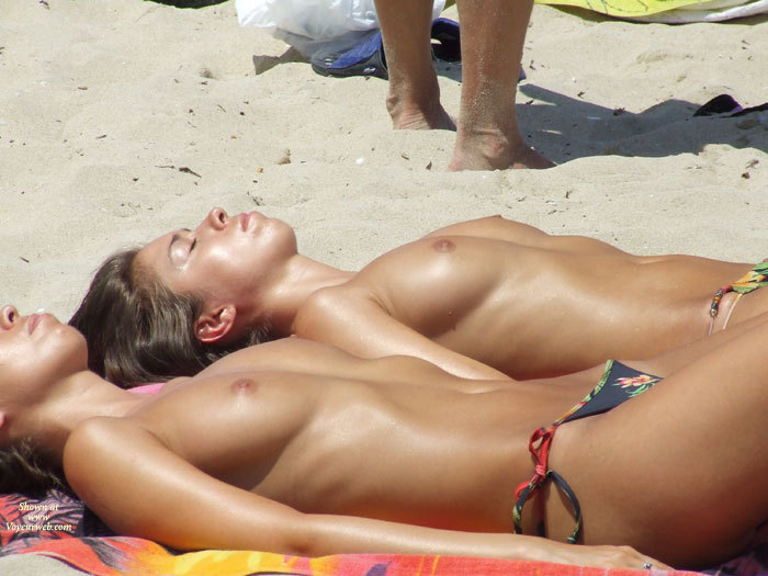 cute girls tanning toppless