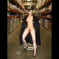 amo aka legs: full length nude brunette flashing with black coat open in store