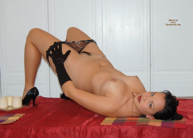 Pic #1 - Nude Girl Lying On A Table - Black Hair, Heels, Landing Strip, Red Hair, Trimmed Pussy, Naked Girl, Nude Amateur, Sexy Face , Black Panty, Undressing Her Panty, Exposed Pubes, Full Red Lips, Perky Breasts, Sexy Eyes, Black Gloves