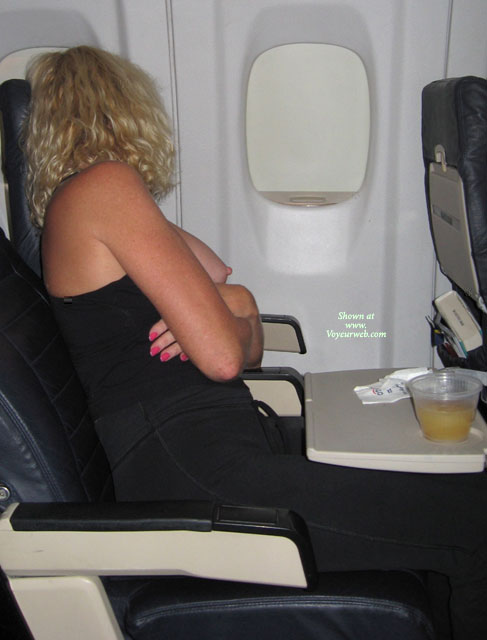 Pic #1 - Naughty Blond With Curls Exposing Tits On An Airplane - Blonde Hair , Sitting On An Airplane, Seated On Airplane, Boob Flash On Airplane, Arms Crossed, Exposed Breast, Mile High Boob, Single Breast Out, Exposed On Airplane