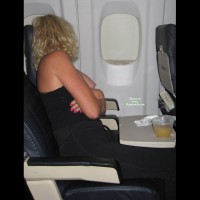 Naughty Blond With Curls Exposing Tits On An Airplane - Blonde Hair