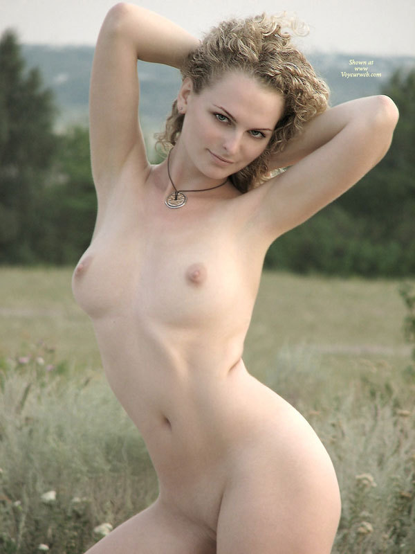 Classic Nude - Blonde Hair, Pale Skin, Naked Girl, Nude Amateur , Pale Skin, Light Areolas, Smooth Body, Standing In Nature, Arms On Head, Standing Full Frontal, Hands Behind Head, Medium Round Breasts, Curly Hairs, Back Arched
