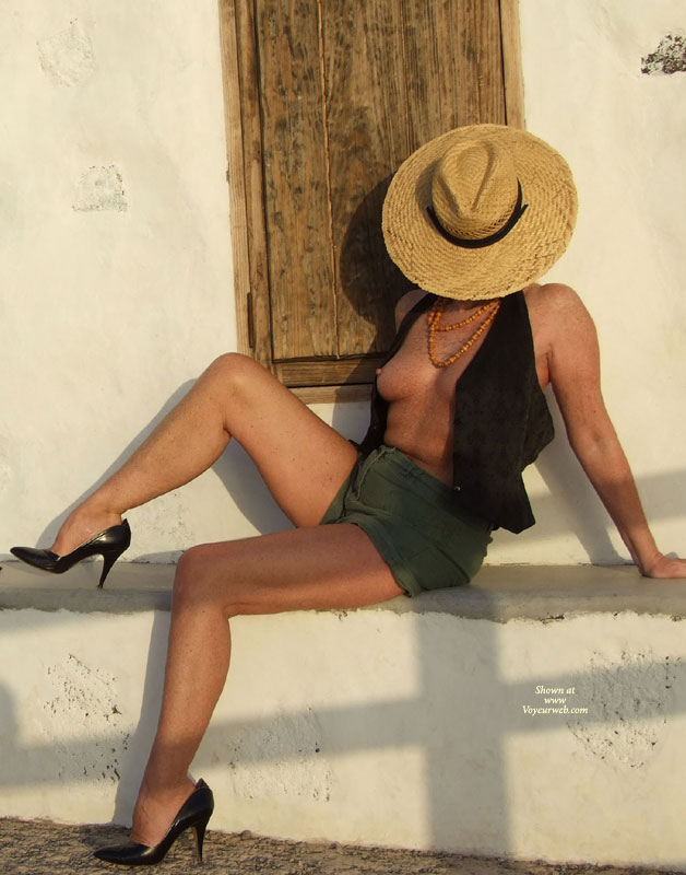 Pic #1 - Exposing Her Tits Through Open Vest - Naked Girl, Nude Amateur , Green Shorts, Sitting Sideways, Sitting On A Ledge, Classic Nude, Black Vest, Very High Heeled Black Pumps, Nice Firm Breast, Straw Hat, Medium Natural Breasts, Shapely Firm Legs
