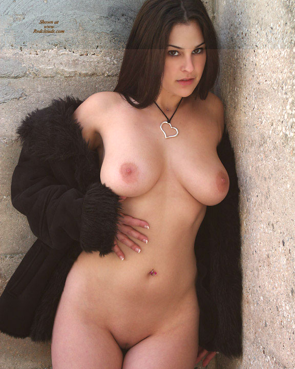 Brunette in sweater naked