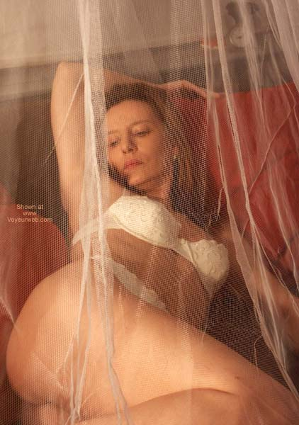 Pic #3 - Susy's Sensual Playing Behind The Net