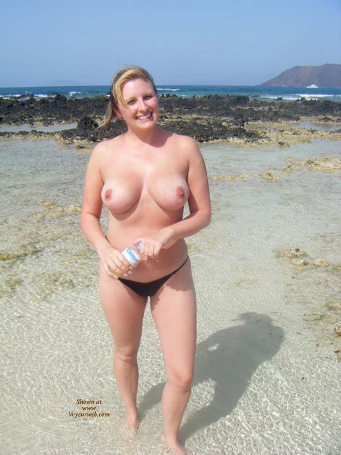 Pic #1 - Topless At The Beach - Big Tits, Blonde Hair, Topless , Solid Breast, Large Round Tits, Topless On A Beach, Big Round Tits, Smiling Into Camera