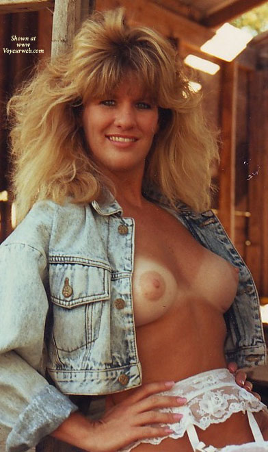 Pic #1 - Open Denim Shirt Displaying Boobs And White Garter Belt - Blonde Hair, Tan Lines, Looking At The Camera , Shoulder Length Blonde Hair, Tanlines With A Blonde Twist, Big Hair Blonde With Denim Shirt Open, Country Girl Breast, Confident Happy Look, Tits With Tan Lines, Big Hair, Leaning Against Barn Door, Denim Jacket Open Exposing Erect Nipples, Puffy Nipples, Bikini Tanlines