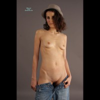 Brunette Naked In Hat And Jeans Pulled Down - Brunette Hair, Dark Hair, Shaved Pussy, Small Breasts, Small Tits