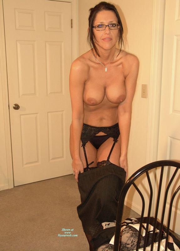 Pic #1 - Girl Undressing At Home - Hard Nipple, Large Aerolas, Stockings, Topless , Glasses, Black Lace Garter-belt, Black Panties, Black Skirt, Black Lace Stockings