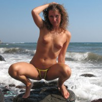 Topless Squatting On Rocks In The Surf - Perky Tits, Small Tits, Topless, Looking At The Camera