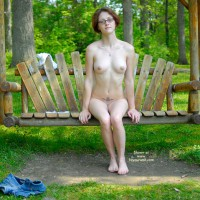 Short Red Hair And Glasses Sitting Nude On Bench Swing - Nude Outdoors, Red Hair, Naked Girl, Nude Amateur