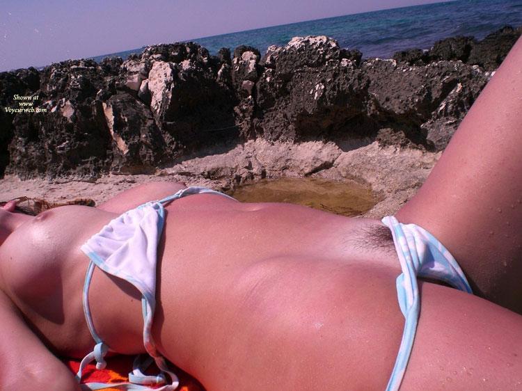 Pic #1 - Bikini Half Off - Hairy Bush, Naked Girl, Nude Amateur , Left Leg Bent At Hip And Knee, Beach Semi-nude, Peek-a-boo Pussy, Beach, Severe Sunburned Skin, Pussy Hair Peeking, Mature Women, Loose Bikini