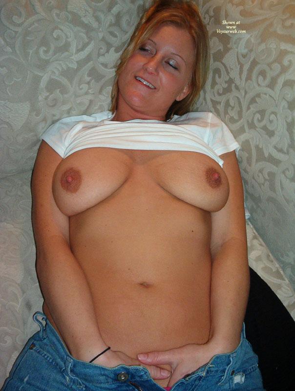 Pic #1 - Enjoying Herself - Big Tits, Erect Nipples , White T-shirt, Lifted White T-shirt, Blue Jeans, Kicking Back, Feeling Good, Indoor Tit Shot, Both Hands Down Pants