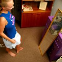 Brittney Examines Herself In Mirror